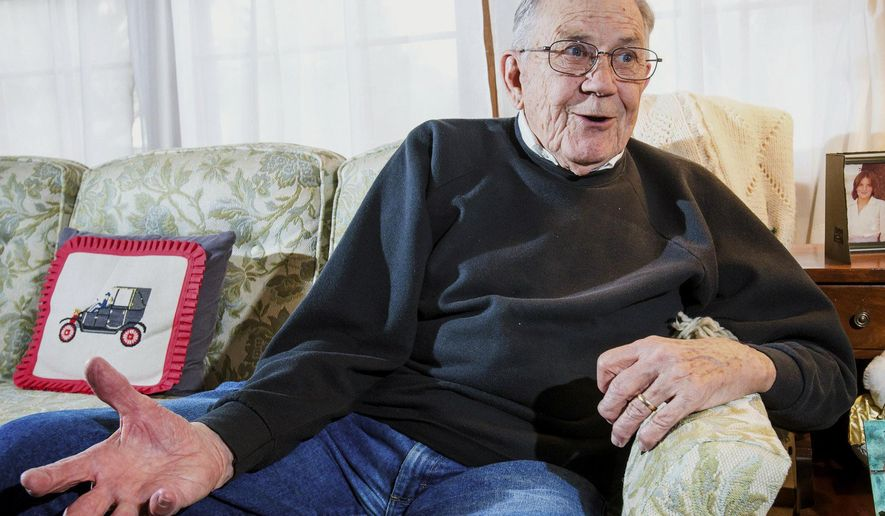 In this March 24, 2015 photo, Harvey Hodges, 89, talks about his experiences during World War II at his home in Champaign, Ill. Days after the invasion of Normandy, Harvey Hodges climbed down a rope ladder onto Utah Beach. Private Hodges was part of a replacement contingent that landed in the first few days after D-Day. (Robin Scholz/The News-Gazette via AP)  (Robin Scholz/The News-Gazette via AP) MANDATORY CREDIT