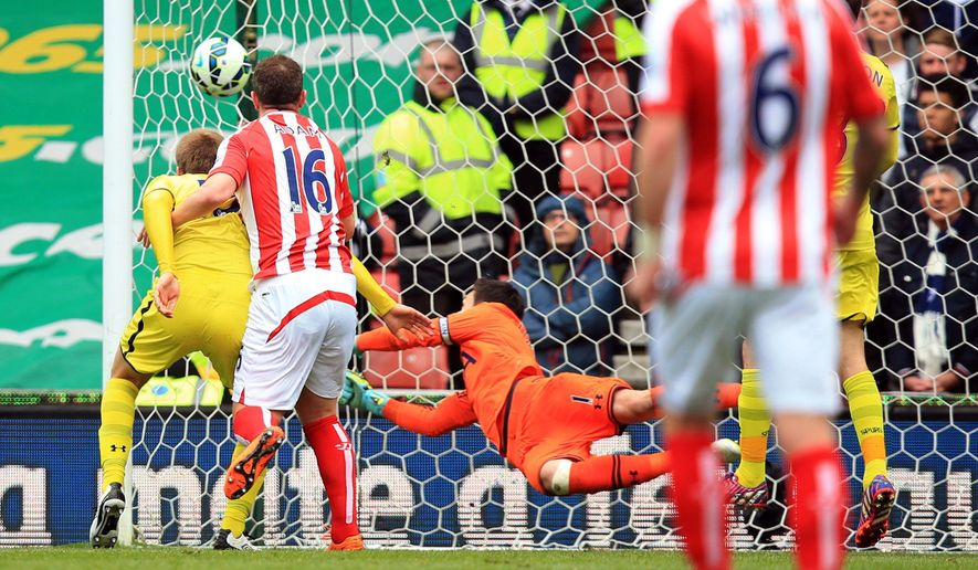 Stoke City's Charlie Adams, second left, scores their first goal against Tottenham during their English Premier League soccer match at the Britannia Stadium, Stoke On Trent, England, Saturday, May 9, 2015. (Mike Egerton/PA via AP)     UNITED KINGDOM OUT      -     NO SALES    -    NO ARCHIVES