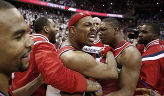 Washington Wizards forward Paul Pierce, in headband, celebrates with his teammates after Game 3 of the second round of the NBA basketball playoffs against the Atlanta Hawks, Saturday, May 9, 2015, in Washington. The Wizards won 103-101. (AP Photo/Alex Brandon)