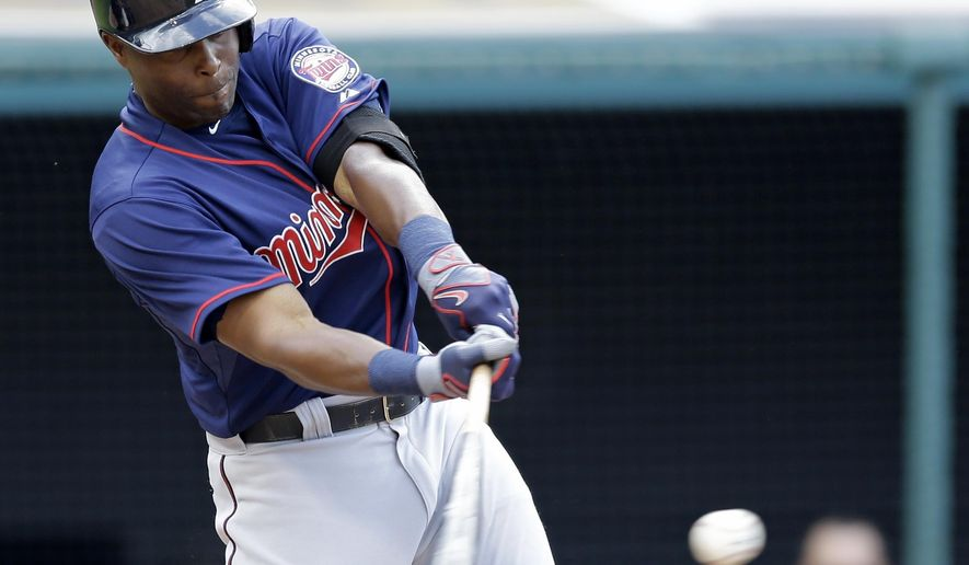 Minnesota Twins' Torii Hunter hits a single off Cleveland Indians starting pitcher Bruce Chen in the third inning of a baseball game, Saturday, May 9, 2015, in Cleveland. (AP Photo/Tony Dejak)