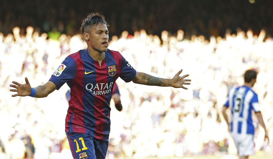 FC Barcelona's Neymar celebrates after scoring against Real Sociedad during a Spanish La Liga soccer match at the Camp Nou stadium in Barcelona, Spain, Saturday, May 9, 2015. (AP Photo/Manu Fernandez)