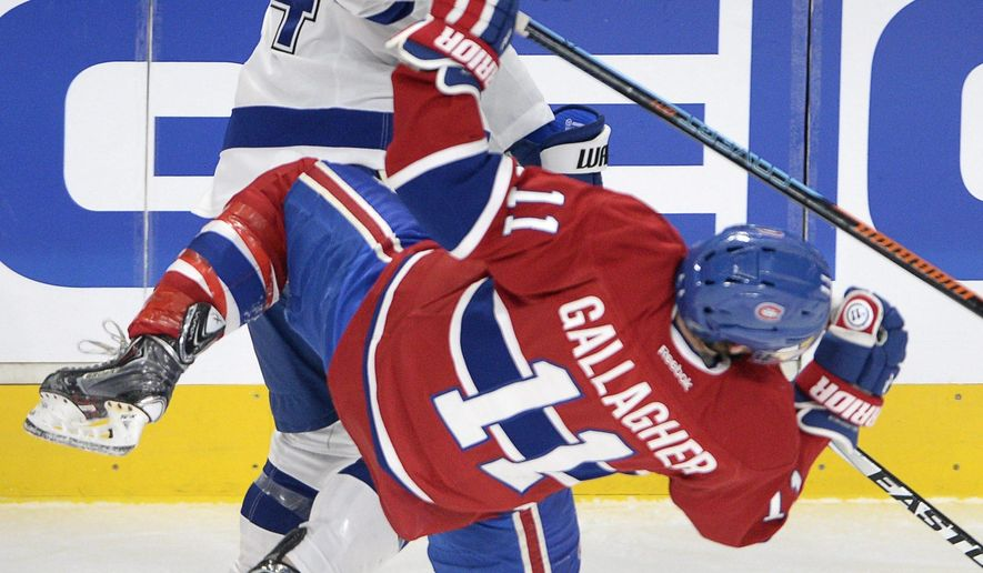 Montreal Canadiens right wing Brendan Gallagher (11) is checked by Tampa Bay Lightning right wing Ryan Callahan (24) during the first period of Game 5 of a second-round NHL Stanley Cup hockey playoff series Saturday, May 9, 2015, in Montreal. (Ryan Remiorz/The Canadian Press via AP) MANDATORY CREDIT