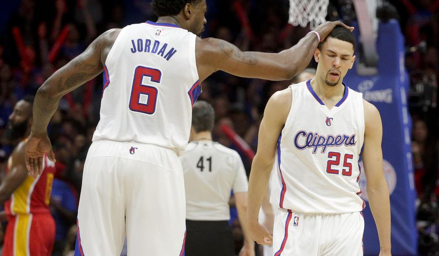 Los Angeles Clippers center DeAndre Jordan, left, celebrates with guard Austin Rivers during the second half of Game 3 in a second-round NBA basketball playoff series against the Houston Rockets, Friday, May 8, 2015, in Los Angeles. (AP Photo/Jae C. Hong)