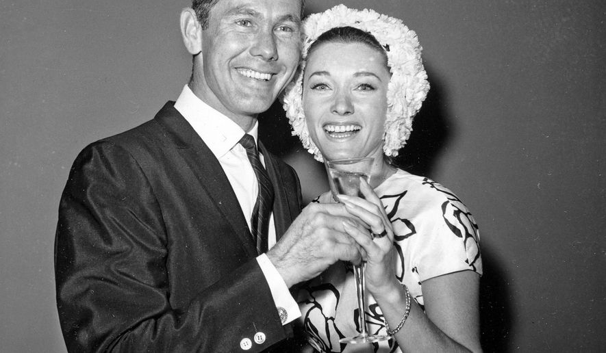 """FILE - This Aug. 17, 1963 file photo shows comedian Johnny Carson and his bride, former television personality and model Joanne Copeland, at a reception in his apartment after their wedding at in New York. Their marriage from 1963 to 1972 ended in divorce. Joanne Carson, who later in life became a close confidant of Truman Capote, died Friday, May 8, 2015 at her home in Los Angeles, according to the executor of her estate. Johnny Carson, who hosted """"The Tonight Show"""" from 1962 to 1992, died in 2005. (AP Photo/File)"""