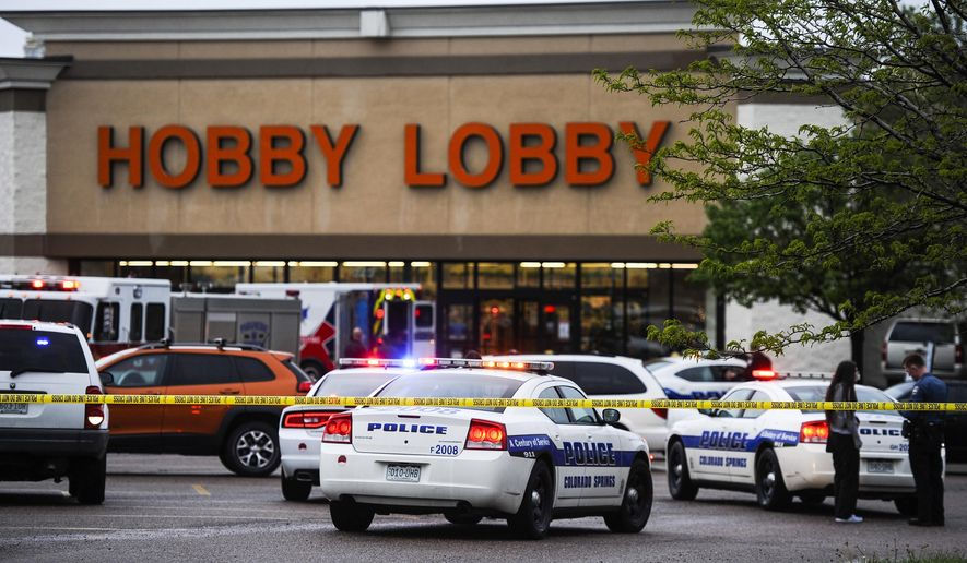 The Colorado Springs Police Department responds to a shooting inside Hobby Lobby off 8th Street in Colorado Springs, Colo. where at least one person was transported from the scene by ambulance Friday, May 8, 2015. Police have said that everything is secure and safe at this time, but have not yet released additional details. (Michael Ciaglo/The Gazette via AP)