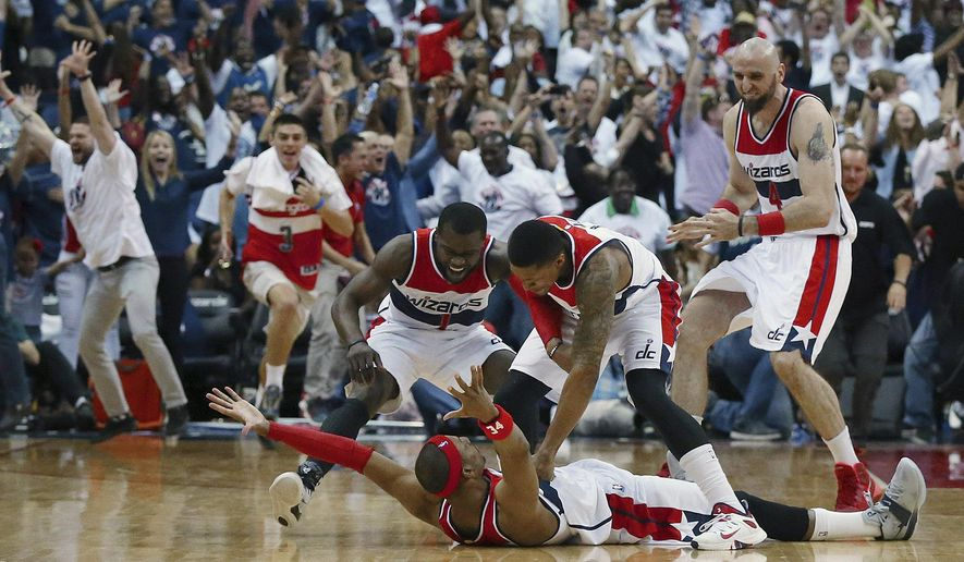 Washington Wizards players mob Paul Pierce on the floor after his game winning shot as time expired after Game 3 of the second round of the NBA basketball playoffs Saturday, May 9, 2015, in Washington. The Wizards won 103-101. (Curtis Compton/Atlanta Journal-Constitution via AP)  MARIETTA DAILY OUT; GWINNETT DAILY POST OUT; LOCAL TELEVISION OUT; WXIA-TV OUT; WGCL-TV OUT