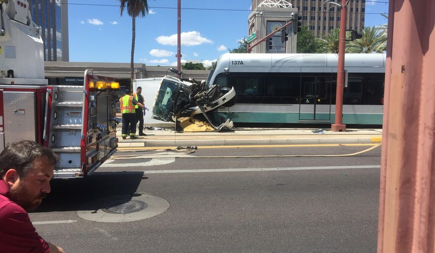 This photo provided by Anthony Mirabal shows the aftermath of a collision between a truck and a Phoenix light rail car in midtown Phoenix on Saturday, May 9, 2015. (AP Photo/Courtesy of Anthony Mirabal)