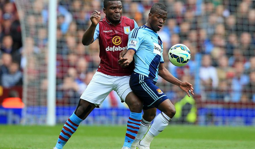 Aston Villa's Jores Okore, left, and West Ham United's Enner Valencia in action during their English Premier League soccer match at Villa Park, Birmingham, England, Saturday, May 9, 2015. (Nick Potts/PA via AP)    UNITED KINGDOM OUT     -    NO SALES     -    NO ARCHIVES