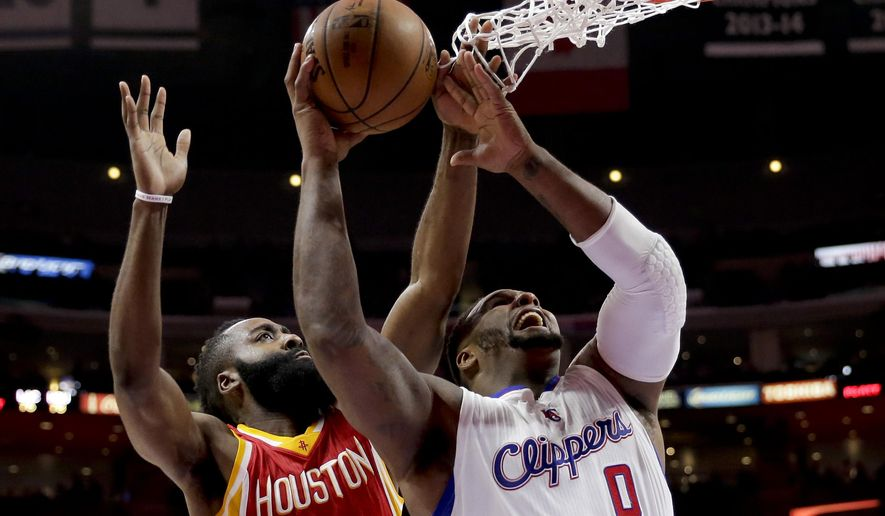 Los Angeles Clippers forward Glen Davis, right, battles Houston Rockets guard James Harden for a rebound during the second half of Game 3 in a second-round NBA basketball playoff series in Los Angeles, Friday, May 8, 2015. (AP Photo/Jae C. Hong)
