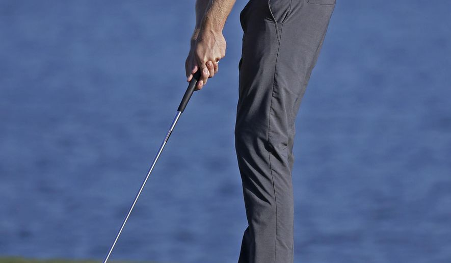Chris Kirk putts for par on the 18th green during the third round of The Players Championship golf tournament Saturday, May 9, 2015, in Ponte Vedra Beach, Fla. (AP Photo/Lynne Sladky)