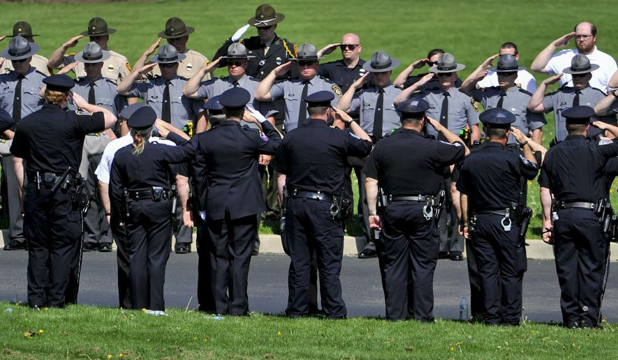 The funeral and procession for Ligonier Township police lieutenant Eric A. Eslary at Holy Trinity Church in Ligonier on Saturday, May 9, 2015. Hundreds of people, including many fellow officers, gathered to say goodbye to the 40-year-old Eslary. The Ligonier Township officer was killed early Tuesday when a van collided head-on with his patrol SUV on Route 30. (Rebecca Droke/Pittsburgh Post-Gazette via AP)