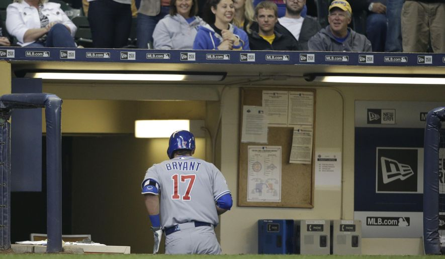 Chicago Cubs' Kris Bryant runs into an empty dugout after his three-run home run against the Milwaukee Brewers during the third inning of a baseball game Saturday, May 9, 2015, in Milwaukee. (AP Photo/Jeffrey Phelps)