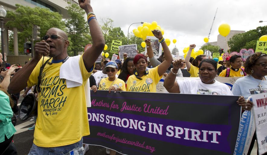 "People march against police brutality as mothers from across the country join the ""Million Moms March"" with the group Mothers For Justice United on Pennsylvania Avenue toward the Department of Justice in Washington, on Saturday, May. 9, 2015. (AP Photo/Jose Luis Magana)"