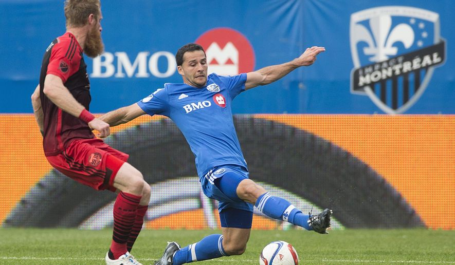 Montreal Impact's Dilly Duka, right, challenges Portland Timbers' Nat Borchers during the second half of a soccer game, Saturday, May 9, 2015 in Montreal. (Graham Hughes/The Canadian Press via AP) MANDATORY CREDIT