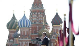 Russian President Vladimir Putin addresses the Victory Parade marking the 70th anniversary of the defeat of the Nazis in World War II, in Red Square, Moscow, Russia, Saturday, May 9, 2015. (AP Photo/Alexander Zemlianichenko, Pool)