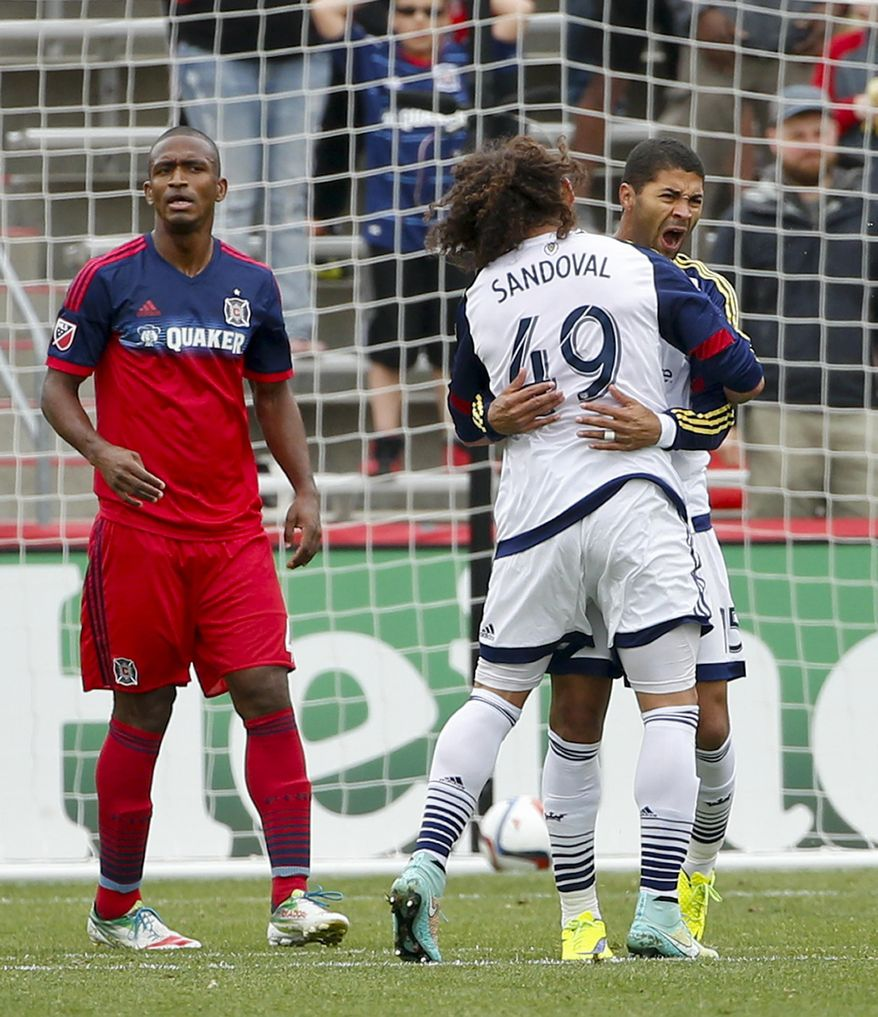 Real Salt Lake forward Alvaro Saboru (15) celebrates with teammate forward Devon Sandoval (49) after scoring against the Chicago Fire during the first half of an MLS soccer game on Saturday, May 9, 2015, at Toyota Park in Bridgeview, Ill. (AP Photo/Kamil Krzaczynski)
