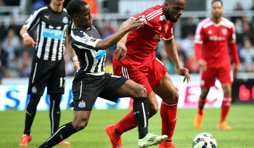 West Bromwich Albion's Victor Anichebe, right, vies for the ball with Newcastle United's Vurnon Anita, left, during their English Premier League soccer match between Newcastle United and West Bromwich Albion at St James' Park, Newcastle, England, Saturday, May 9, 2015. (AP Photo/Scott Heppell)