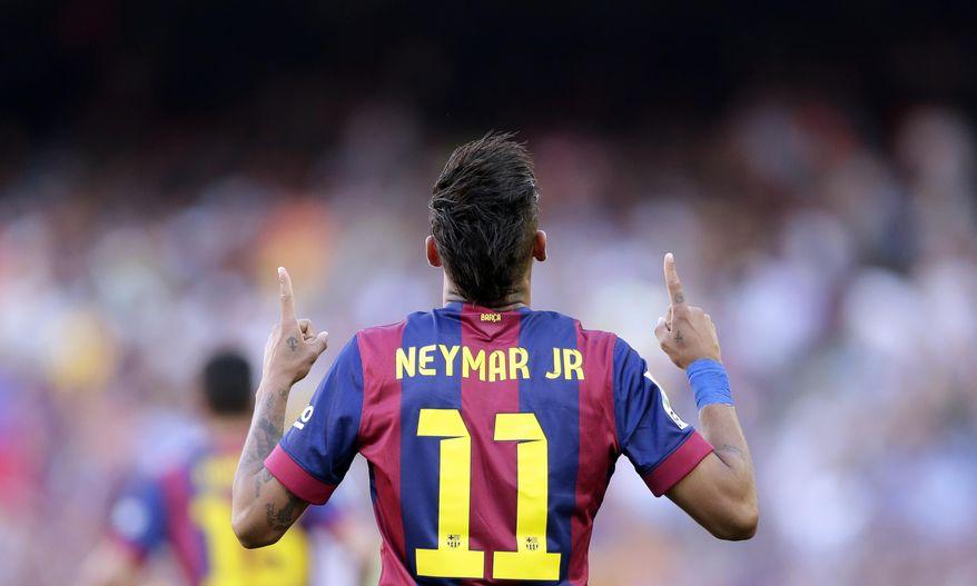 FC Barcelona's Neymar celebrates after scoring against Real Sociedad during a Spanish La Liga soccer match at the Camp Nou stadium in Barcelona, Spain, Saturday, May 9, 2015. (AP Photo/Manu Fernandez)