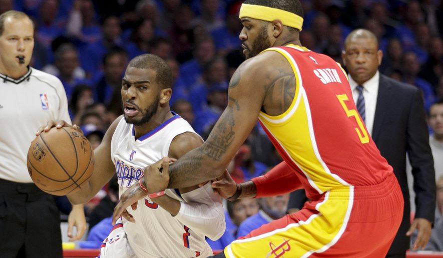 Los Angeles Clippers guard Chris Paul, left, drives around Houston Rockets forward Josh Smith during the first half of Game 3 in a second-round NBA basketball playoff series Friday, May 8, 2015, in Los Angeles. (AP Photo/Jae C. Hong)