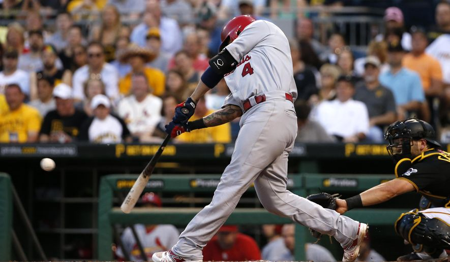 St. Louis Cardinals' Yadier Molina drives in two runs with a double off Pittsburgh Pirates starting pitcher Vance Worley in the fourth inning of a baseball game in Pittsburgh, Saturday, May 9, 2015. (AP Photo/Gene J. Puskar)