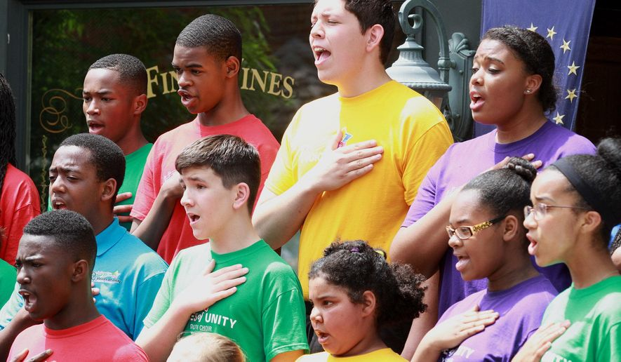The Voices of Unity Youth Choir sings The National Anthem during Republican Marlin Stutzman's conference to announce his plan to run for US Senate next year at 191 N. Main St. Roanoke, Ind., on Saturday May 9, 2015. The seat is currently held by Dan Coats, who is not seeking re-election. (Rachel Von/The Journal-Gazette via AP)