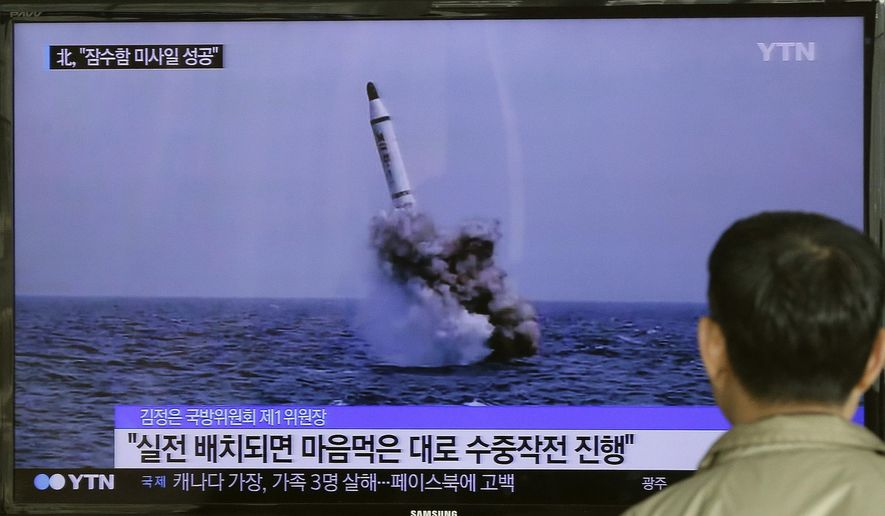 "A South Korean man watches a TV news program showing an image published in North Korea's Rodong Sinmun newspaper of North Korea's ballistic missile believed to have been launched from underwater, at Seoul Railway station in Seoul, South Korea, Saturday, May 9, 2015. North Korea said Saturday it has successfully test-fired a newly developed ballistic missile from a submarine in what would be the latest display of the country's advancing military capability. The letters on the screen read ""The submarine-launched missile would enable the country to conduct  whatever military operation it wants at sea"".  (AP Photo/Ahn Young-oon)"