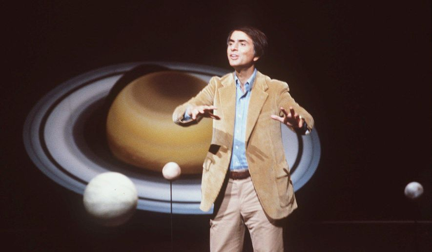 """In this 1981 file photo, astronomer Carl Sagan speaks during a lecture. On Saturday, May 9, 2015, Cornell University announced that its Institute for Pale Blue Dots is to be renamed the Carl Sagan Institute. Sagan was famous for extolling the grandeur of the universe in books and shows like """"Cosmos."""" He died in 1996 at age 62. (AP Photo/Castaneda, File)"""