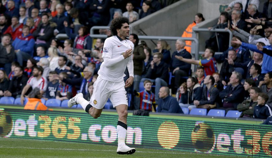 Manchester United's Marouane Fellaini celebrates scoring his side's second goal during the English Premier League soccer match between Crystal Palace and Manchester United at Selhurst Park stadium in London, Saturday, May 9, 2015.  (AP Photo/Matt Dunham)