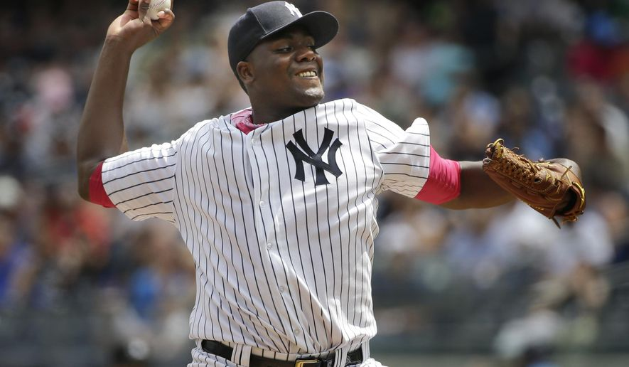 New York Yankees starting pitcher Michael Pineda throws during the second inning of the baseball game against the Baltimore Orioles at Yankee Stadium, Sunday, May 10, 2015, in New York. (AP Photo/Seth Wenig)