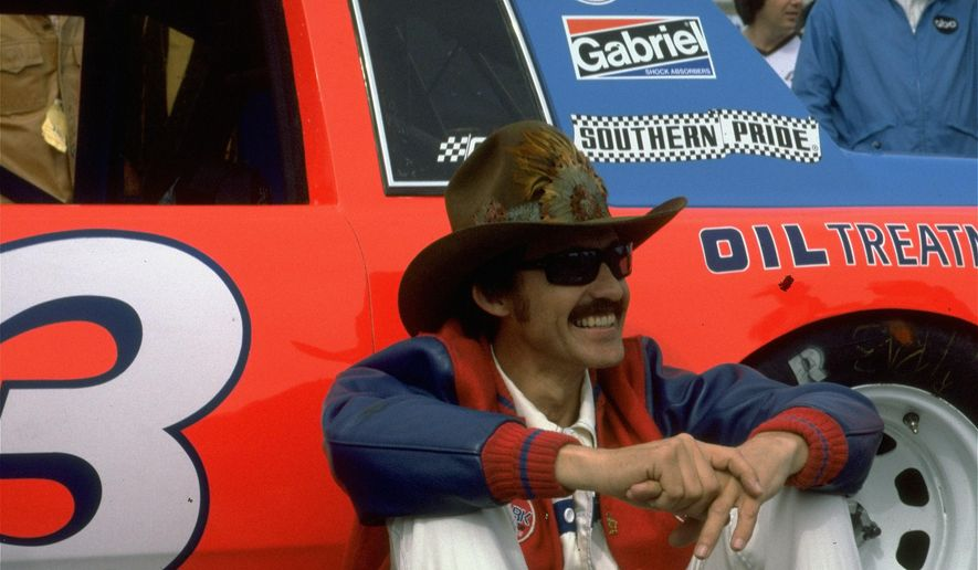 FILE - In this February 1981 file photo, Richard Petty sits by his car at a NASCAR auto race. If you ain't cheatin', you ain't tryin'. The credit for that old saying generally goes to NASCAR legend Petty, though it just as easily could've come from Tom Brady, Gaylord Perry or pretty much any of the millions who have thrown, pitched or hit a ball since people started playing sports. Blurring the line between legal and illegal, then figuring out how to get away with it, is as old as keeping score. (AP Photo, File)