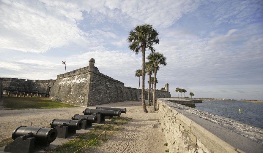 In this Tuesday, Feb. 3, 2015 photo, the Castillio de San Marcos fort, built over 450 years ago, is separated from the Matanzas River by a sea wall in St. Augustine, Fla. St. Augustine is one of many chronically flooded Florida communities afraid their buildings and economies will be inundated by rising seas in just a couple of decades. (AP Photo/John Raoux)