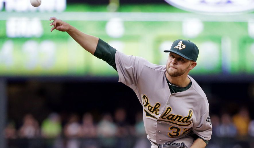 Oakland Athletics starting pitcher Jesse Hahn throws against the Seattle Mariners during the first inning of a baseball game Saturday, May 9, 2015, in Seattle. (AP Photo/Elaine Thompson)