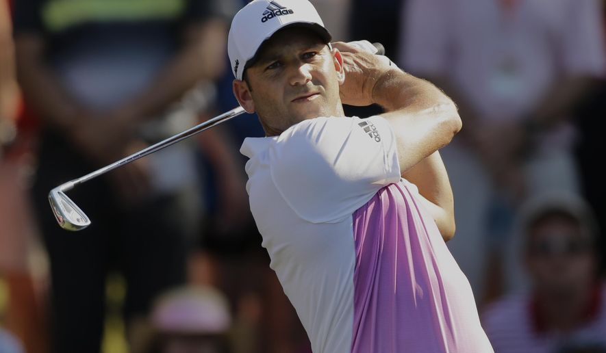 Sergio Garcia, of Spain, hits from the 12th tee during the final round of The Players Championship golf tournament Sunday, May 10, 2015, in Ponte Vedra Beach, Fla. (AP Photo/Chris O'Meara)