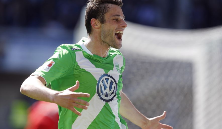 CORRECTS IDENTITY - Wolfburg's Christian Traesch celebrates after scoring during the German first division Bundesliga soccer match between SC Paderborn and VfL Wolfsburg in Paderborn, Germany, Sunday, May 10, 2015. (AP Photo/Frank Augstein)