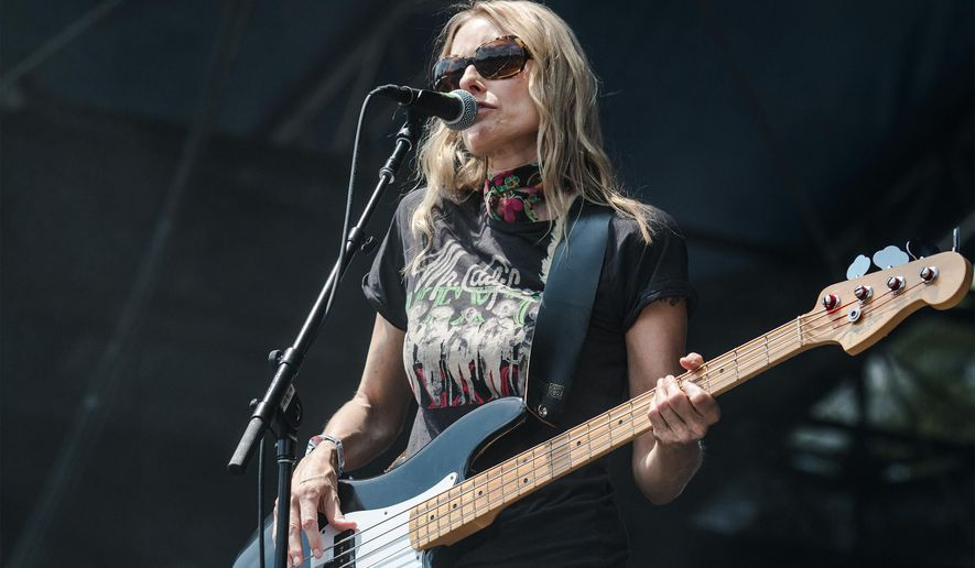 Aimee Mann, singer and bassist for the band The Both, performs at the third annual Shaky Knees Music Festival on Sunday, May 10, 2015, in Atlanta. Mann is the former lead singer of the band 'Til Tuesday. (AP Photo/Ron Harris)