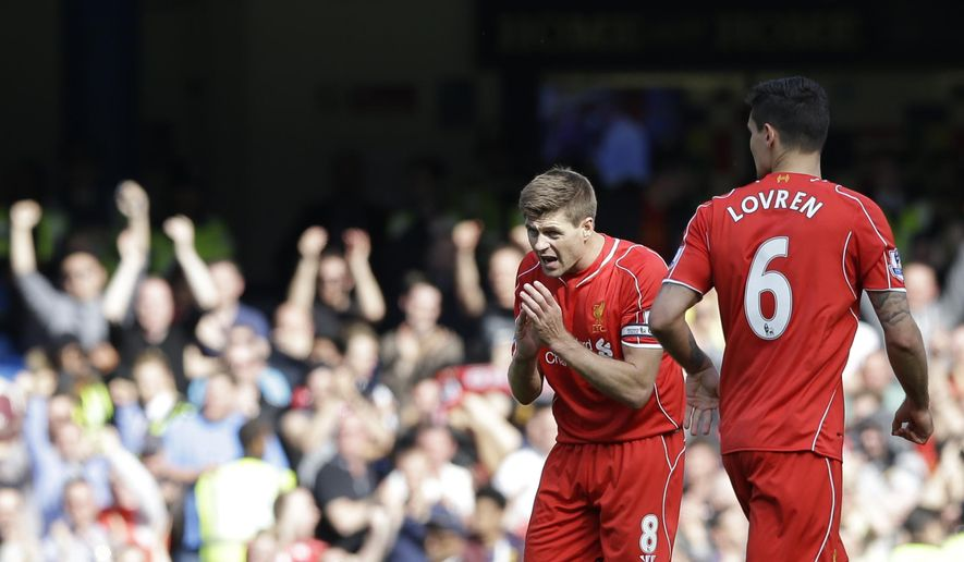Liverpool's Steven Gerrard, left, celebrates scoring his side's first goal during their English Premier League soccer match between Chelsea and Liverpool at Stamford Bridge stadium in London, Sunday, May 10,  2015. (AP Photo/Matt Dunham)