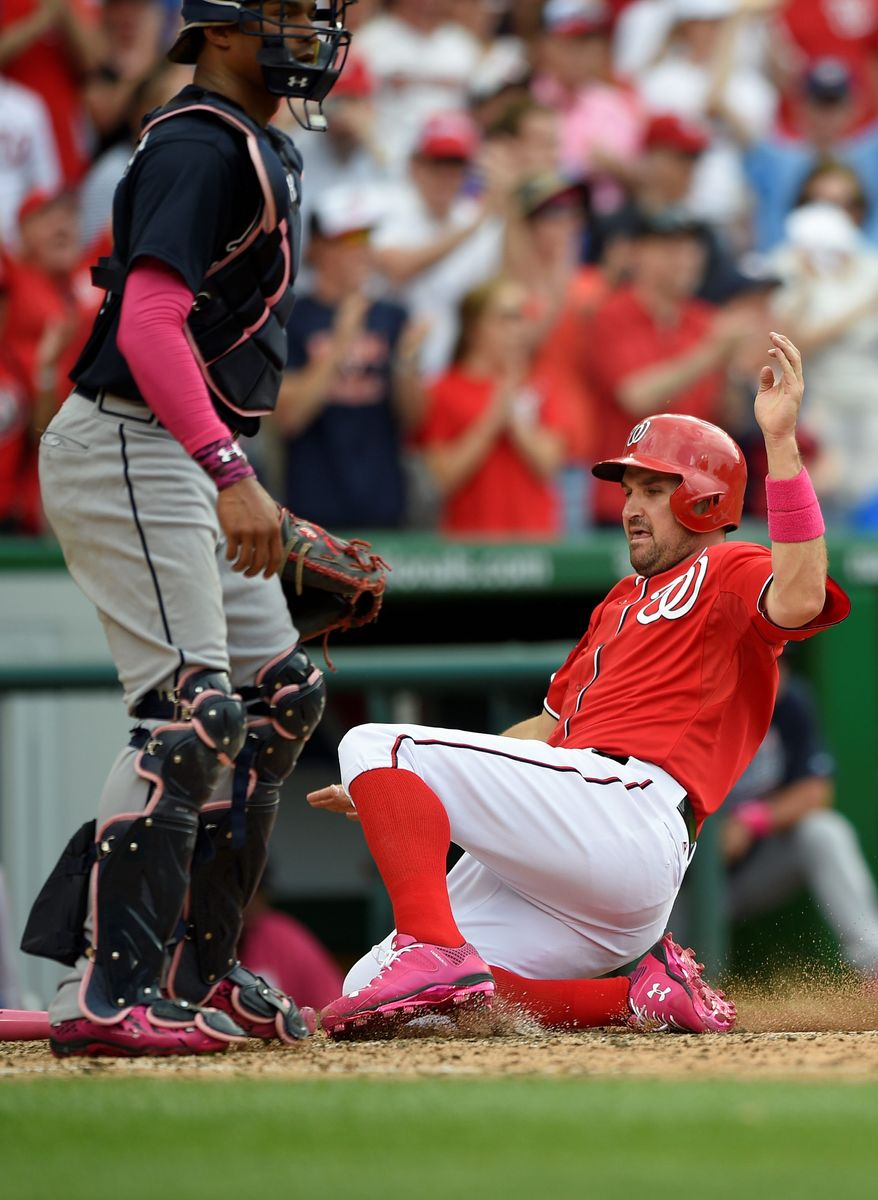 The Nationals' Ryan Zimmerman slides home to score the game's winning run on a double by Wilson Ramos in the eighth inning of a 5-4 win over the Atlanta Braves on Sunday. (Associated Press)