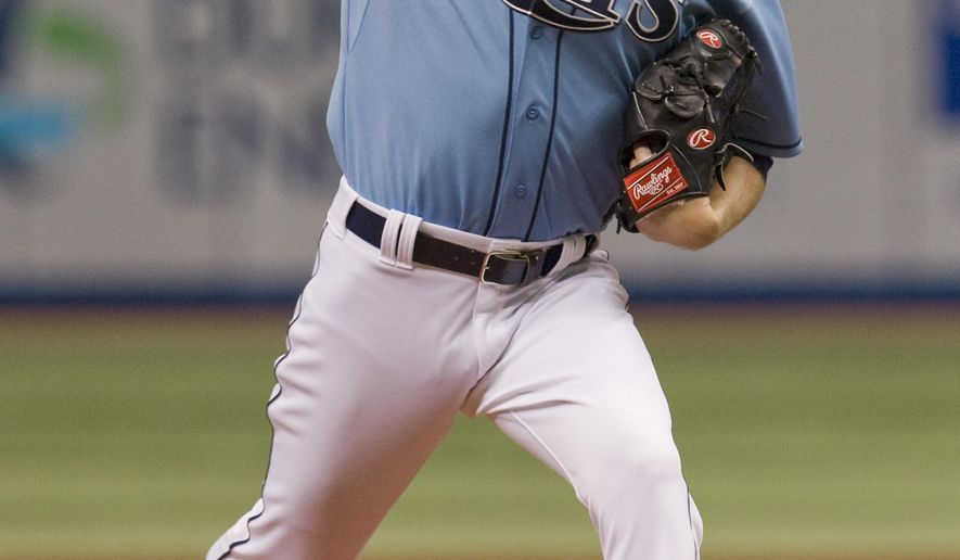 Tampa Bay Rays starting pitcher Jake Odorizzi throws against the Texas Rangers during the first inning of a baseball game Sunday, May 10, 2015, in St. Petersburg, Fla. (AP Photo/Steve Nesius)