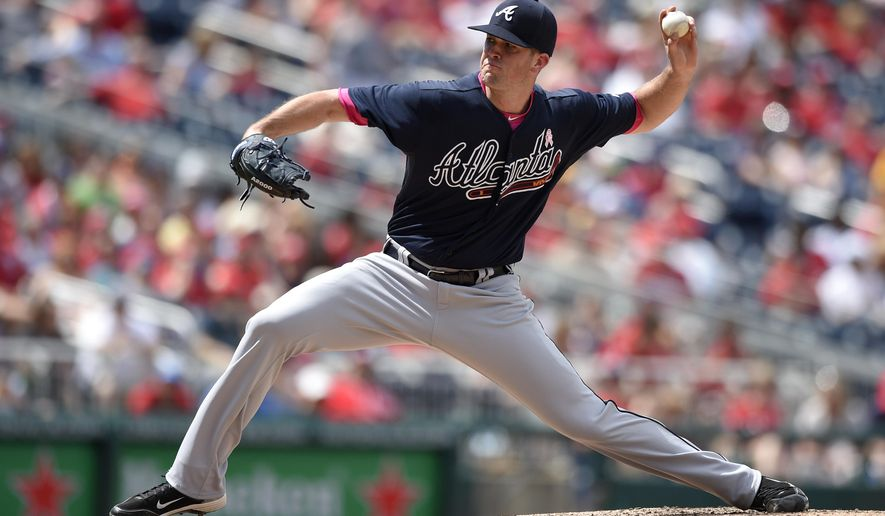Atlanta Braves starting pitcher Alex Wood delivers a pitch against the Washington Nationals during the fourth inning of a baseball game, Sunday, May 10, 2015, in Washington. (AP Photo/Nick Wass)