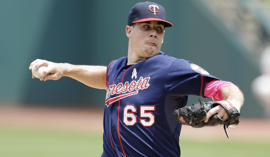 Minnesota Twins starting pitcher Trevor May delivers in the first inning of a baseball game against the Cleveland Indians, Sunday, May 10, 2015, in Cleveland. (AP Photo/Tony Dejak)