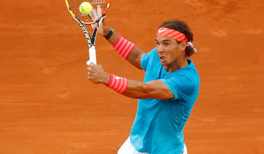 Rafael Nadal of Spain returns a ball to Andy Murray of Great Britain  during the final of the Madrid Open Tennis tournament in Madrid, Spain, Sunday, May 10, 2015. (AP Photo/Daniel Ochoa de Olza)