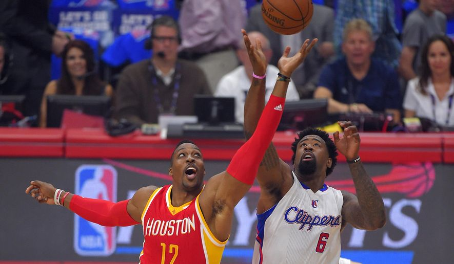 Houston Rockets center Dwight Howard, left, and Los Angeles Clippers center DeAndre Jordan battle for the tipoff during the first half in Game 4 of a second-round NBA basketball playoff series, Sunday, May 10, 2015, in Los Angeles. (AP Photo/Mark J. Terrill)