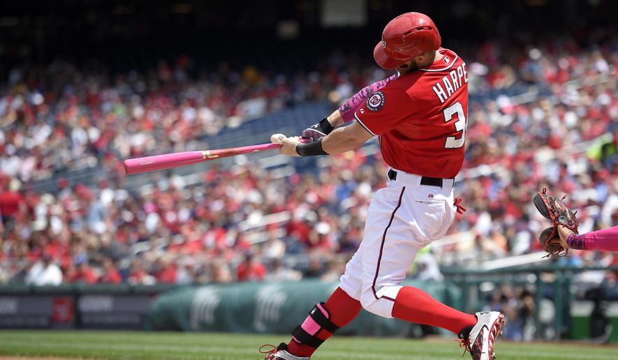 Washington Nationals' Bryce Harper hits a double against the Atlanta Braves during the first inning of a baseball game, Sunday, May 10, 2015, in Washington. (AP Photo/Nick Wass)