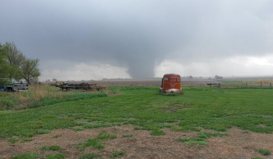 A tornado cuts through parts of Delmont, S.D., Sunday, May 10, 2015. South Dakota Department of Public Safety spokeswoman Kristi Turman said about 20 buildings were damaged and the town has no water, power or phones. (Doug Gunnare via AP) MANDATORY CREDIT