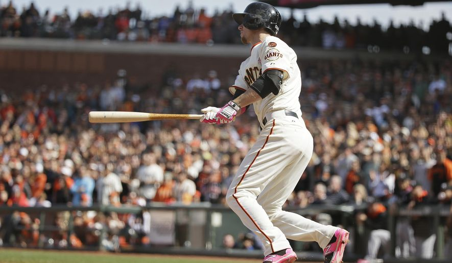 San Francisco Giants' Matt Duffy hits a walk off single off Miami Marlins relief pitcher Steve Cishek in the ninth inning of their baseball game Sunday, May 10, 2015, in San Francisco. San Francisco won the game 3-2. (AP Photo/Eric Risberg)
