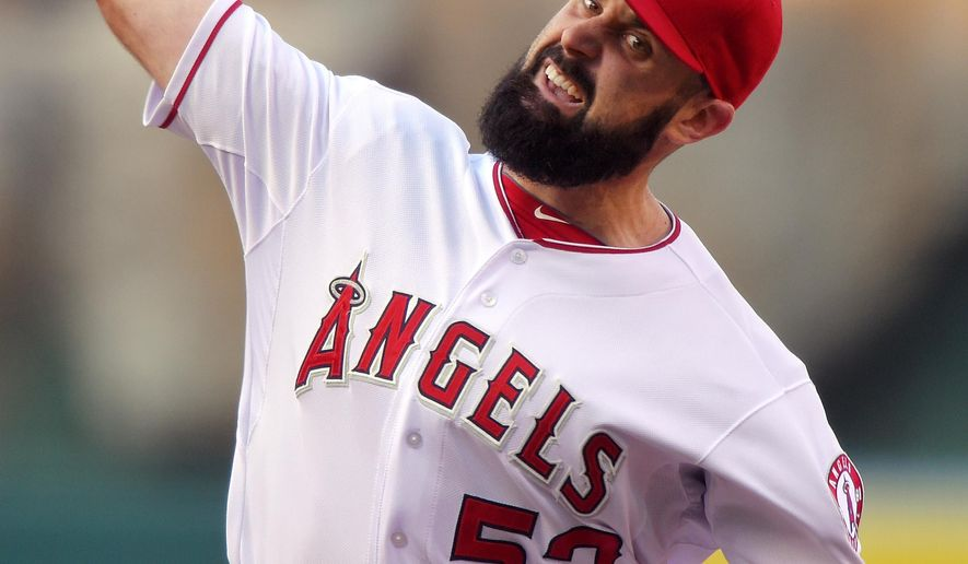 Los Angeles Angels starting pitcher Matt Shoemaker throws to the plate during the first inning of a baseball game against the Houston Astros, Saturday, May 9, 2015, in Anaheim, Calif. (AP Photo/Mark J. Terrill)