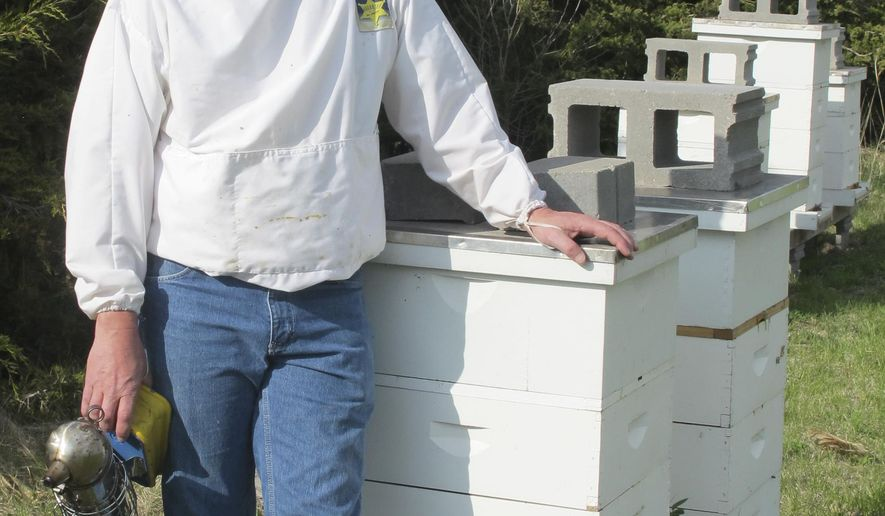 ADVANCE FOR THE WEEKEND OF MAY 9-10 AND THEREAFTER - Ron Babcock, owner of Babcock Farms in Glenvil, Neb. seen in a Tuesday, April 28, 2015 photo, has been beekeeping for five years. Babcock has 25 hives on his farm, each hive has 4 to 10 boxes and each box contains 10 frames. (Erica Blakley/Hastings Tribune via AP)
