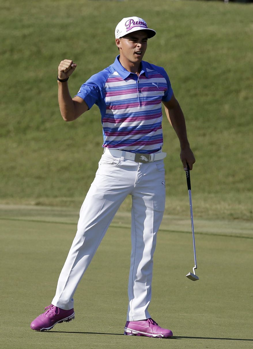 Rickie Fowler celebrates after making a birdie putt on the 18th hole during the final round of The Players Championship golf tournament Sunday, May 10, 2015, in Ponte Vedra Beach, Fla. (AP Photo/Lynne Sladky)