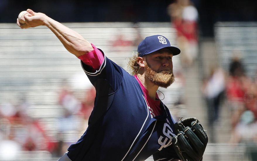 San Diego Padres' Andrew Cashner throws a pitch against the Arizona Diamondbacks during the first inning of a baseball game, Sunday, May 10, 2015, in Phoenix. (AP Photo/Ross D. Franklin)