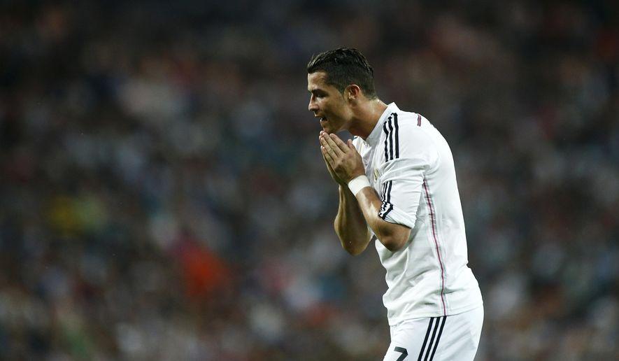 Real Madrid's Cristiano Ronaldo during a Spanish La Liga soccer match at the Santiago Bernabeu stadium in Madrid, Spain, Saturday May 9, 2015. (AP Photo/Oscar del Pozo)